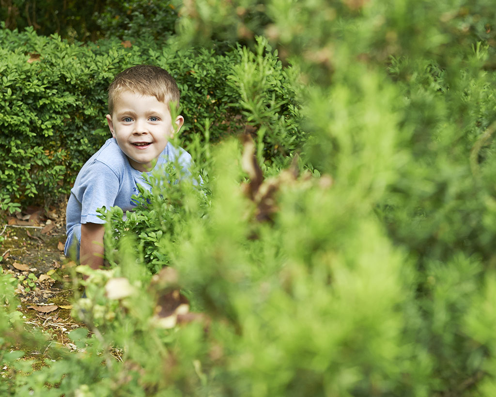portrait of a boy playing in nature